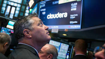 Tom Reilly, chief executive officer of Cloudera Inc., stands during the company's initial public offering (IPO) on the floor of the New York Stock Exchange (NYSE) in New York.