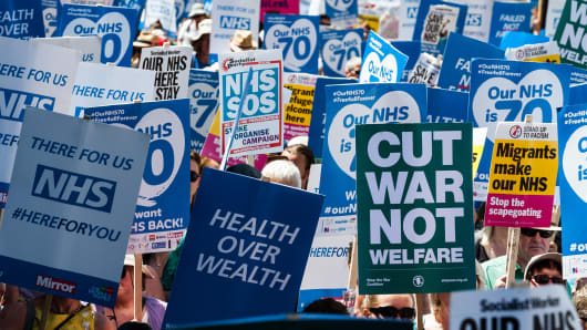 Protesters call for an end to austerity policies which lead to underfunding and staff shortages in the NHS, and demand that it remains publicly owned and accessible to everyone. June 30, 2018 in London, England.