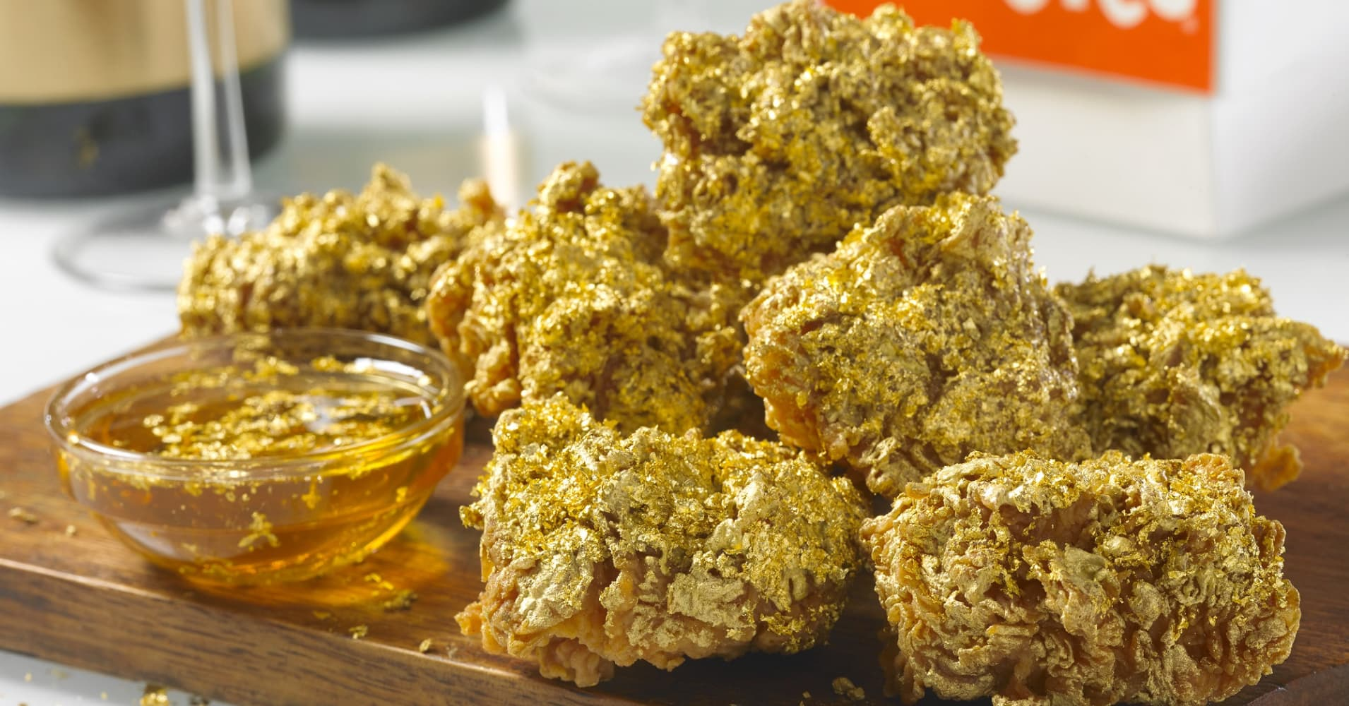 Image result for Popeye's Has Champagne-Dipped, 24-Karat Gold-Battered Chicken Wings