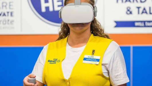 A Walmart employee takes a STRIVR course on Oculus Go.