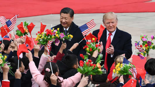 Chinese President Xi Jinping welcomes U.S. President Donald Trump outside the east gate of the Great Hall of the People in Beijing, China on Nov. 9, 2017.
