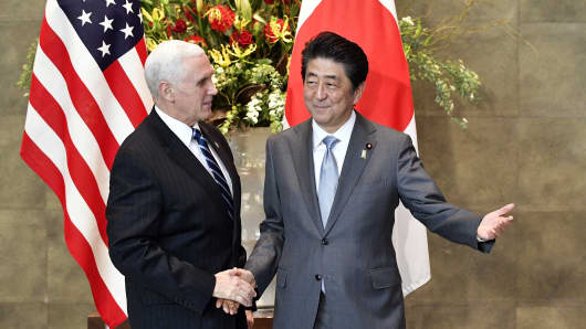 US Vice President Mike Pence (L) is welcomed by Japan's Prime Minister Shinzo Abe (R) upon his arrival at the prime minister's official residence in Tokyo on February 7, 2018.