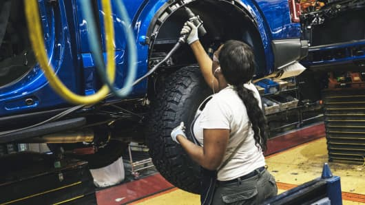 An employee works on the line at the Ford Motor Co. Dearborn Truck Plant in Dearborn, Michigan, Sept. 27, 2018.
