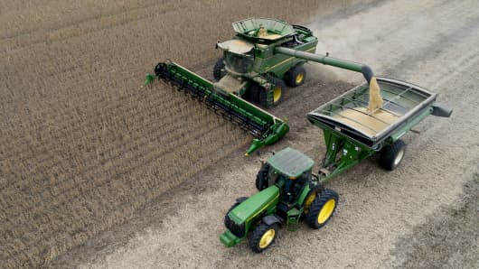 Soybeans are harvested with a Deere & Co. combine harvester in this aerial photograph taken above Tiskilwa, Illinois.