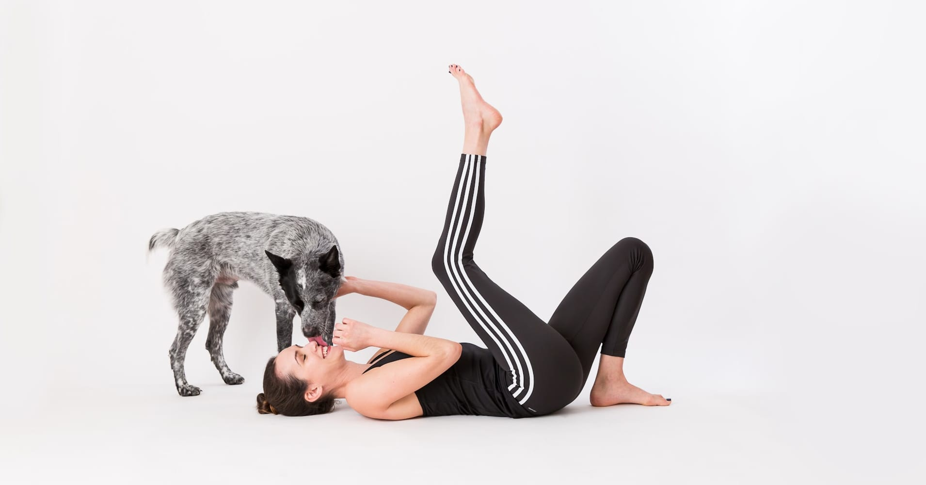 "Adriene Mishler, host of ""Yoga with Adriene"" with her sidekick, Benji."