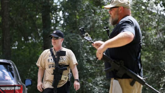 C.J. Grisham (L), founder of Open Carry Texas, and Greg Holland, a member of Open Carry Texas, openly carry firearms in Houston, Texas, September 24, 2018.