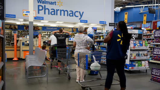 Shoppers wait in line at the pharmacy of a Walmart store in Charlotte, North Carolina, Sept. 13, 2018.
