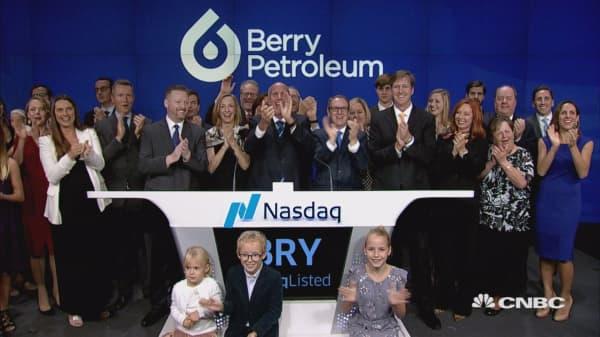 Executives at Berry Petroleum ring the closing bell at the Nasdaq