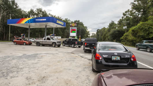 People line up for gasoline as Hurricane Michael bears down on the northern Gulf coast of Florida on October 8, 2018 outside Tallahassee, Florida. Michael was forecast to become a Category 3 storm with sustained winds of 120 mph when it makes landfall in the Florida panhandle later this week.