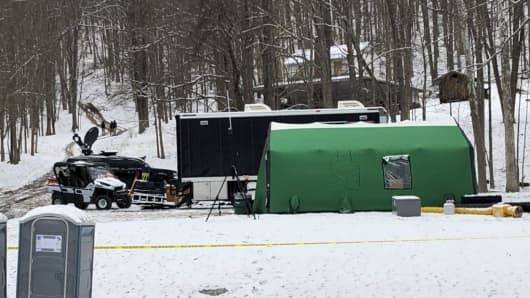 In this March 13, 2018 photo, an FBI tent is seen behind police tape at the base of a hill where investigators were conducting an excavation for Civil War-era gold in Dents Run, Pa.