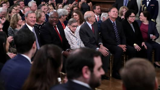 (L-R) U.S. Supreme Court Chief Justice John Roberts and Associate Justices Clarence Thomas, Ruth Bader Ginsburg, Stephen Breyer, Samuel Alito, Sonia Sotomayor and Elena Kagan attend the ceremonial swearing in of Associate Justice Brett Kavanaugh in the East Room of the White House October 08, 2018 in Washington, DC