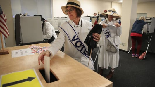 A woman dressed as a suffragette casts her ballot for the midterm elections at the Polk County Election Office on October 8, 2018 in Des Moines, Iowa.Today was the first day of early voting in the state.