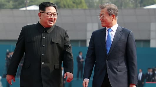 North Korean leader Kim Jong Un (L) and South Korean President Moon Jae-in (R) walk after the official welcome ceremony for the Inter-Korean Summit on April 27, 2018 in Panmunjom, South Korea.