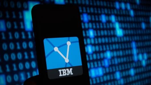 IBM  logo is seen on a mobile phone...