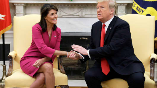 President Donald Trump meets with outgoing U.S. Ambassador to the United Nations Nikki Haley in the Oval Office of the White House, Tuesday, Oct. 9, 2018, in Washington.