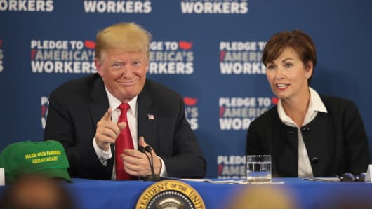 PEOSTA, IA - JULY 26: Iowa Governor Kim Reynolds (R)  and President Donald Trump participate in a round table at Northeast Iowa Community College on July 26, 2018 in Peosta, Iowa.