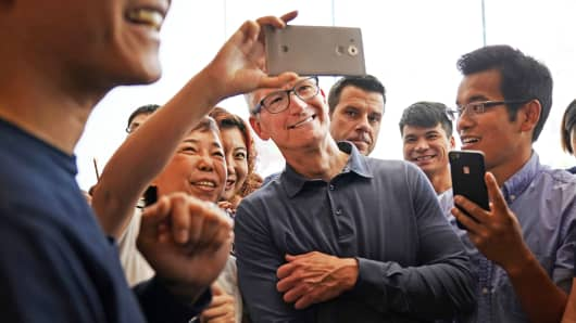 Apple CEO Tim Cook visits an Apple store in Shanghai, China.