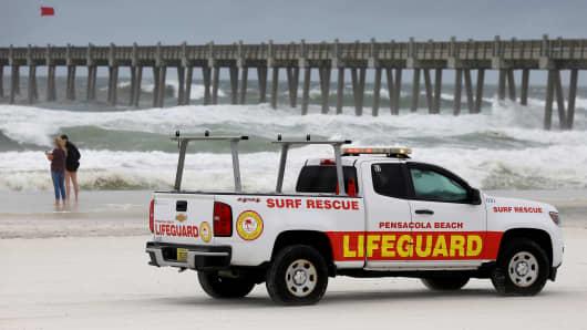 Lifeguards patrol the beach in advance of Hurricane Michael in Pensacola, Florida, U.S. October 9, 2018.