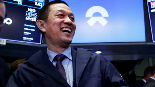 Bin Li, CEO of Chinese electric vehicle start-up NIO Inc., celebrates after ringing a bell as NIO stock begins trading on the floor of the New York Stock Exchange (NYSE) during the company's initial public offering (IPO) at the NYSE in New York, September 12, 2018.