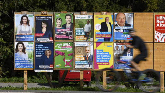 Bad Feilnbach, GERMANY - OCTOBER 6: A cyclist rides past several election campaign posters on October 6, 2018 in Bad Feilnbach, Germany. (Photo by Andreas Gebert/Getty Images)