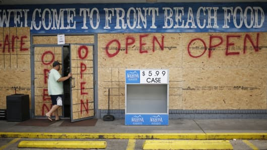 A customer enters a boarded up gas station ahead of Hurricane Michael in Panama City Beach, Florida, U.S., on Tuesday, Oct. 9, 2018. Michael, a Category 2 hurricane, is racing toward the Florida panhandle and is forecast to become the second storm to make U.S. landfall in a month.