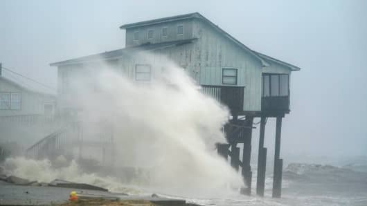 Waves take over a house as Hurricane Michael comes ashore in Alligator Point, Florida, October 10, 2018.