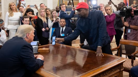 President Donald Trump meets with rapper Kanye West (R) in the Oval Office of the White House in Washington, DC, on October 11, 2018.