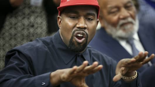 Rapper Kanye West speaks during a meeting with U.S. President Donald Trump in the Oval office of the White House on October 11, 2018 in Washington, DC.