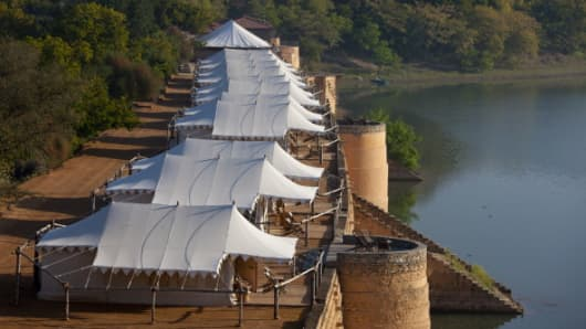 Chhatra Sagar reservoir and luxury tented camp oasis in Rajasthan, Northern India.