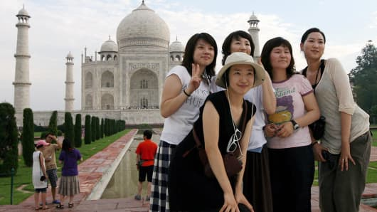 Tourists pose at the Taj Mahal.