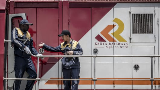 Railway workers inspect a Kenya Railways Corp. freight train before departure from the port station in Mombasa, Kenya, on Saturday, Sept. 1, 2018.