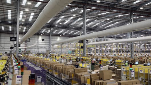 Parcels are processed and prepared for dispatch at Amazon's fulfillment center in Peterborough, England.