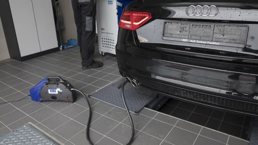 Emissions testing equipment, manufactured by AVL Ditest GmbH, sits connected to the exhaust of an Audi AG A5 diesel automobile at a garage in Bruchkoebel, Germany, on Wednesday, July 26, 2017.