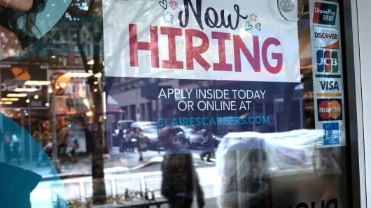 A now hiring sign is displayed in the window of a Brooklyn business on October 5, 2018 in New York, United States.