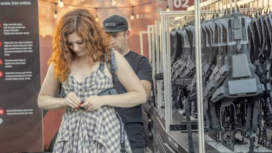 Singer-songwriter Mandy Harvey, who is deaf, outfitted with a Music: Not Impossible harness that allows the hard of hearing to experienceevery bass line, every drum beat, every guitar chord and every vocal at a concert.