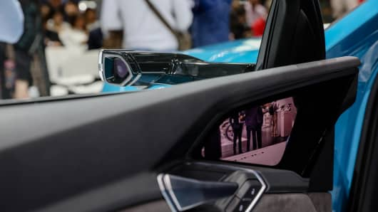 A monitor displays wing-mirror video camera footage inside an Audi e-Tron.