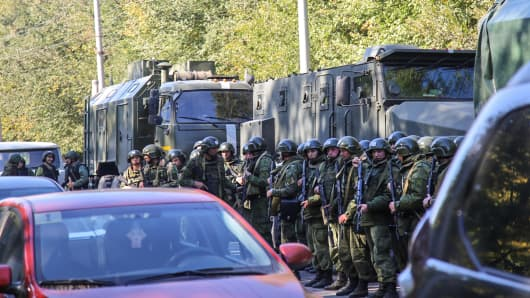 Special forces servicemen patrol a blast site at a college in the city of Kerch on October 17, 2018.