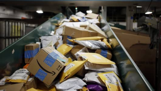 Packages are seen on a conveyor belt with other small parcels at the United States Postal Service (USPS) sorting center in Louisville, Kentucky.
