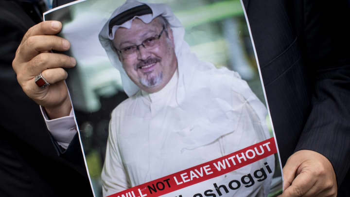 A man holds a poster of Saudi journalist Jamal Khashoggi during a protest organized by members of the Turkish-Arabic Media Association at the entrance to Saudi Arabia's consulate on October 8, 2018 in Istanbul, Turkey.