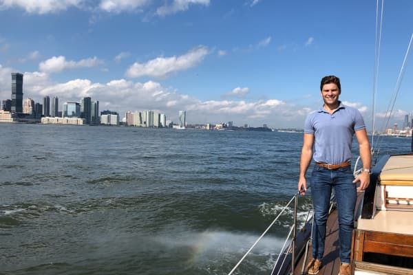 CNBC producer Chris DiLella onboard the Mark Hotel's sailboat on New York City's Hudson River.