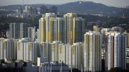 Blocks of Housing & Development Board (HDB) apartments stand in Singapore, on Friday, Dec. 28, 2012.