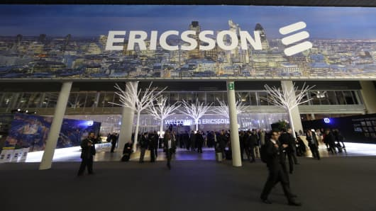 Visitors pass through the entrance to the Ericsson AB pavilion at the Mobile World Congress in Barcelona, Spain, on Tuesday, Feb. 26, 2013.