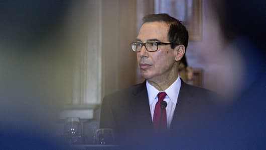 Steven Mnuchin, U.S. Treasury secretary, listens during a Financial Stability Oversight Council (FSOC) meeting at the U.S. Treasury in Washington, D.C., U.S., on Tuesday, Oct. 16, 2018.