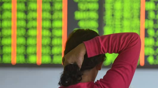 A investor monitors stock prices at a securities company in Hangzhou in China's eastern Zhejiang province on October 18, 2018.