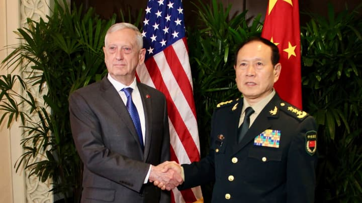 US Defence Secretary Jim Mattis with his Chinese counterpart General Wei Fenghe during a meeting on the sidelines of the Association of Southeast Asian Nations security summit in Singapore on October 18, 2018.