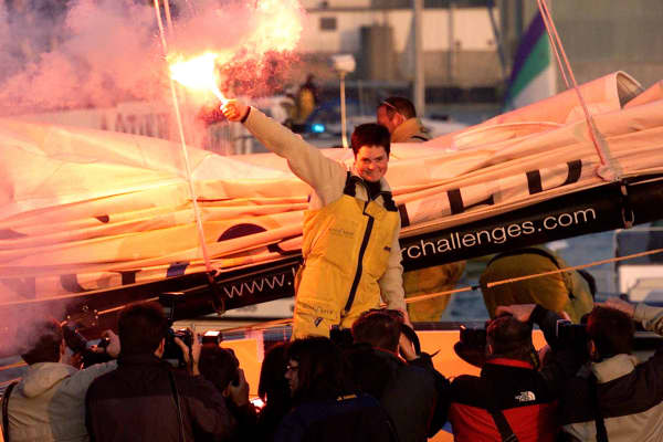 Yachtswoman Ellen MacArthur arrives in England after her record breaking finish in the Vendee Globe race.