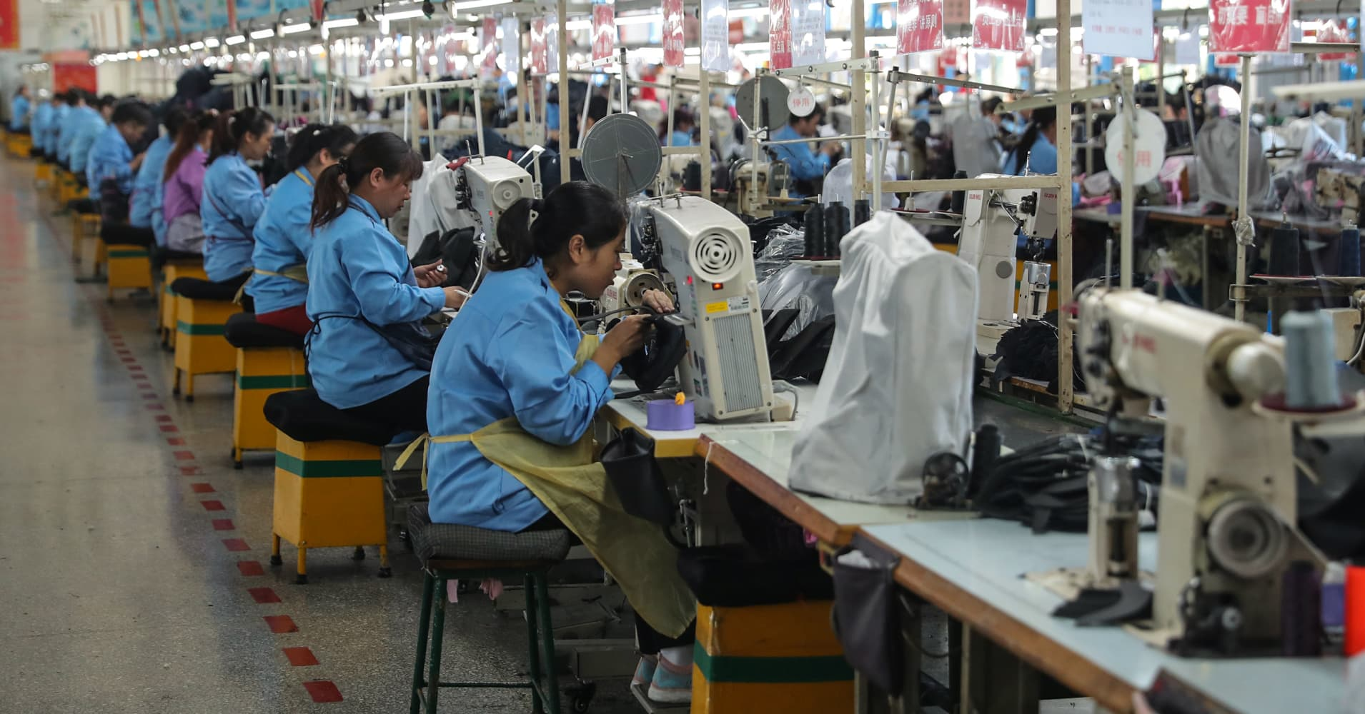 China industrial output, investment beat forecasts while retail sales miss expectations