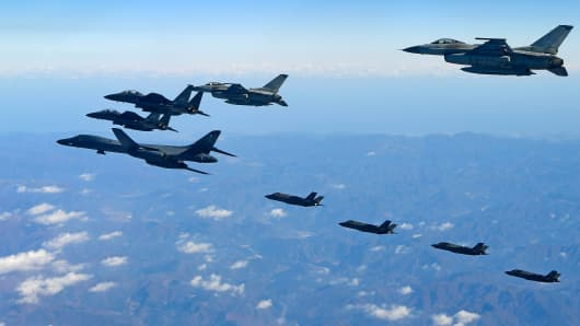 In this handout image provided by South Korean Defense Ministry, U.S. Air Force B-1B bomber (L), South Korea and U.S. fighter jets fly over the Korean Peninsula during the Vigilant air combat exercise (ACE) on December 6, 2017 in Korean Peninsula, South Korea.