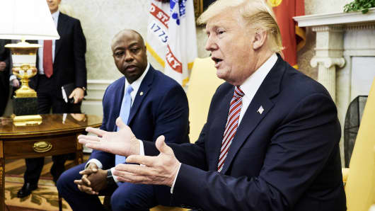 President Donald Trump, right, speaks while Senator Tim Scott, a Republican from South Carolina, listens during a working session regarding the Opportunity Zones provided by tax reform in the Oval Office of the White House in Washington, D.C., U.S., on Wednesday, Feb. 14, 2018.