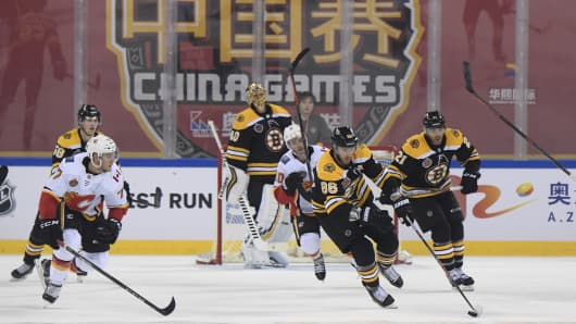 Kevan Miller #86 of the Boston Bruins skates with the puck against the Calgary Flames at the Cadillac Arena on September 19, 2018 in Beijing, China.